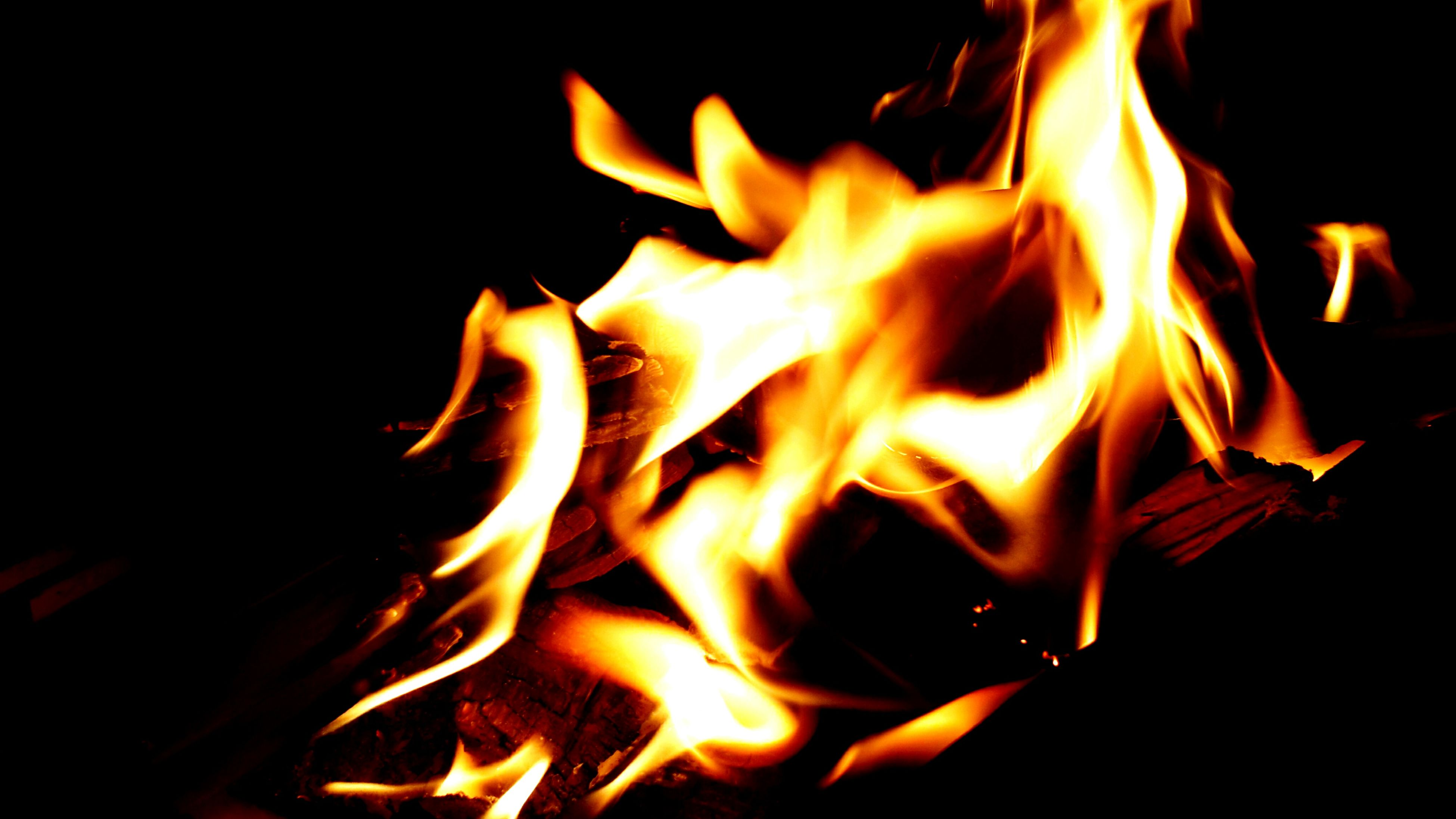 burning, flame, fire - natural phenomenon, heat - temperature, glowing, night, bonfire, close-up, fire, firewood, orange color, illuminated, heat, campfire, dark, studio shot, motion, black background, lit, light - natural phenomenon