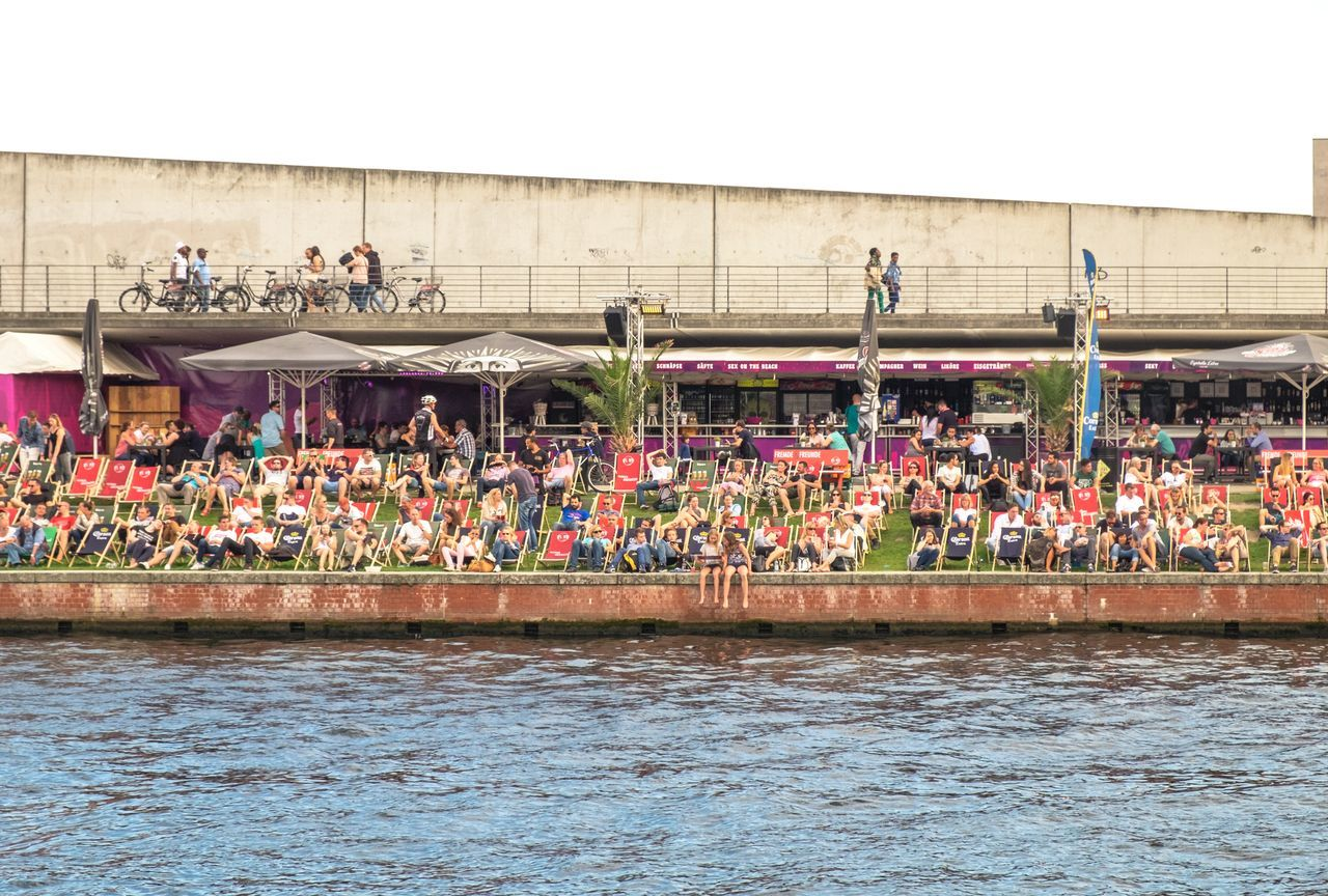 Adults Only Architecture Bar Built Structure Copy Space Crowd Deck Chair Drinking Enjoying Life Enjoyment Large Group Of People Leisure Activity Music Outdoors People Real People Relaxation River Riverside Spree River Summer Tourism Water Waterfront
