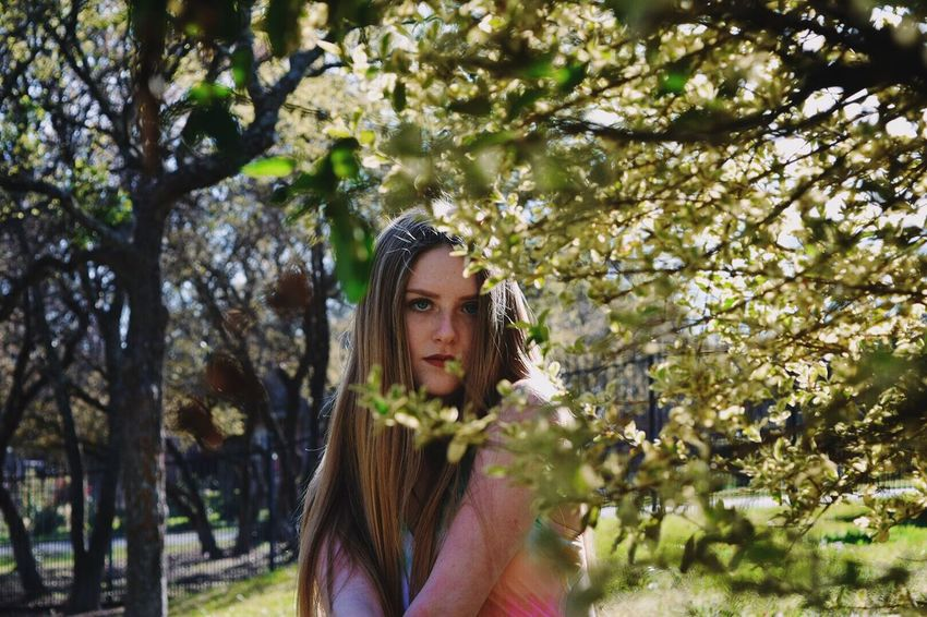 Bush Green Throughthetrees Nature Girl Beauty Solitude Somber Blonde Long Hair Portrait Young Adult One Person Front View Outdoors Day Photo