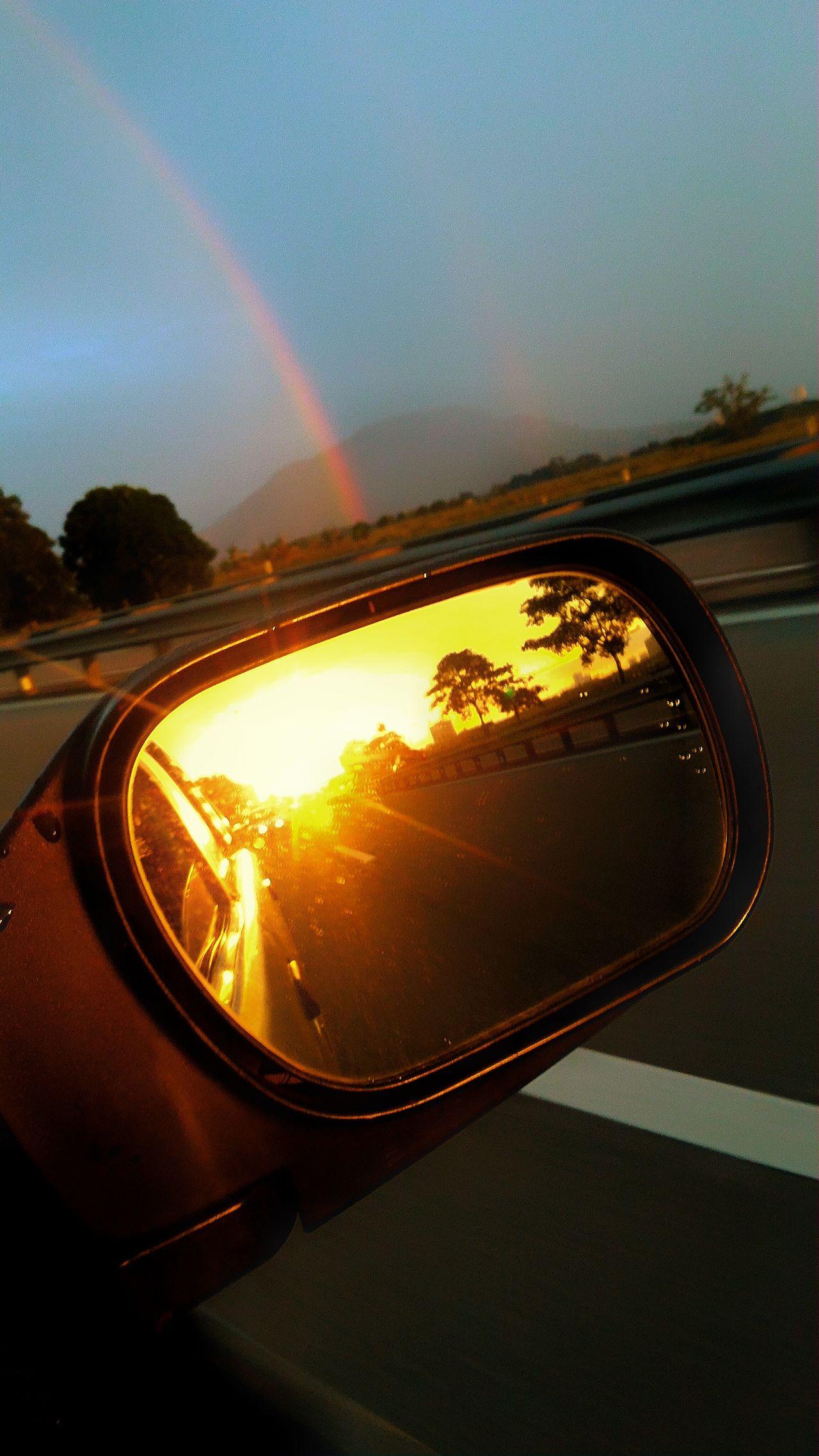 Enjoying The Sunset Rainbow