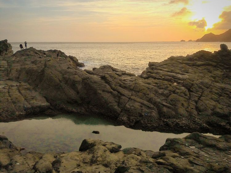 Natural salt water pool (lagoon) at Wediombo Beach Yogyakarta Beach Sea Horizon Over Water Sunset Dramatic Sky Sun Sky Landscape Sunlight Outdoors Vacations Nature Tranquility Travel Destinations Wediombobeach Gunungkidul Yogyakarta Wonderful Indonesia Lagoon Lagoon Water Landscape_photography Photography Takenbyme Conected Whit Travel Lost In The Landscape
