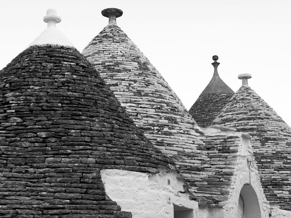 Alberobello Alberobello - Puglia Alberobello City Alberobellocity Alberobelloexperience Alberobellophotocontest Ancient Ancient Civilization Architecture Building Exterior Built Structure Clear Sky Day History Low Angle View No People Outdoors Place Of Worship Religion Sky Spirituality Travel Destinations