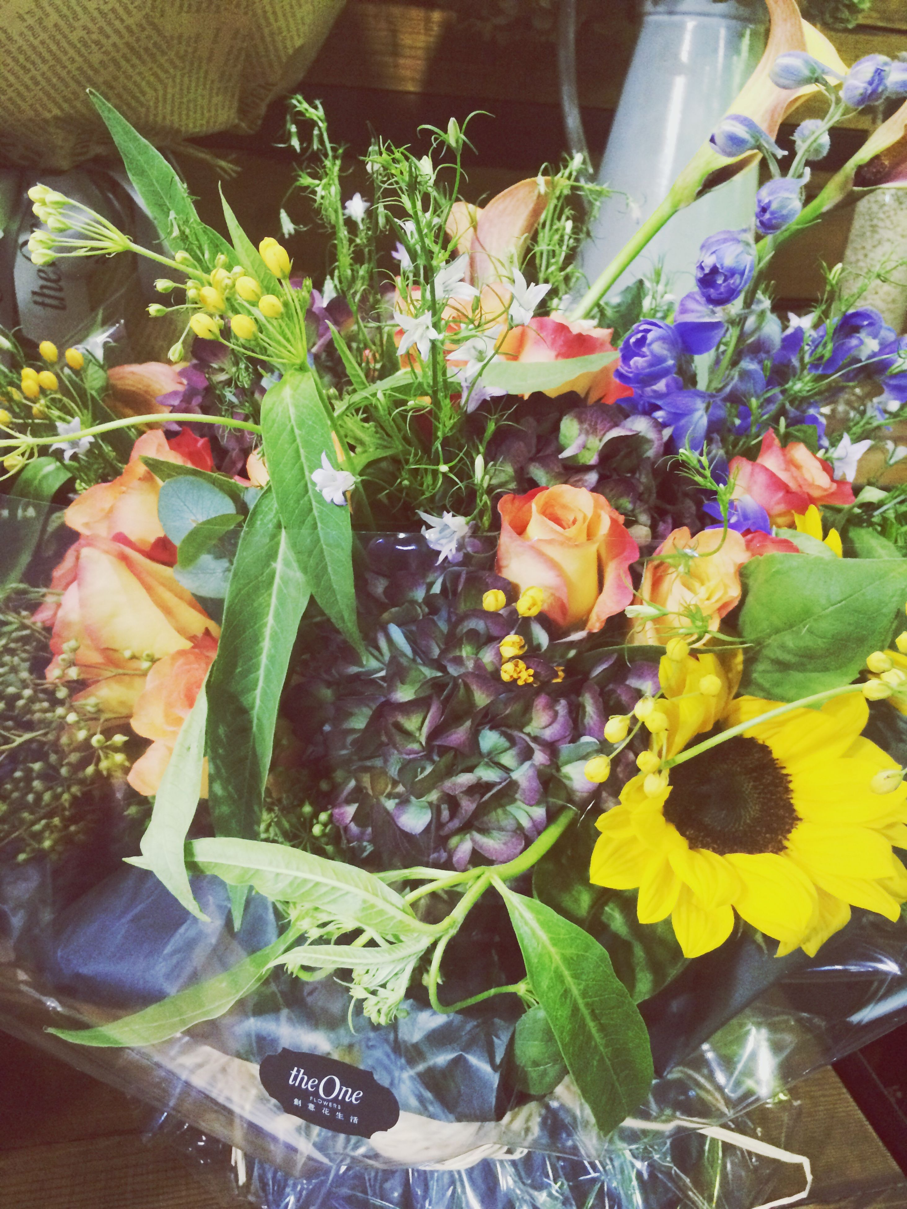 freshness, indoors, flower, variation, high angle view, for sale, large group of objects, abundance, choice, fragility, arrangement, potted plant, plant, still life, retail, multi colored, table, petal, vase, no people