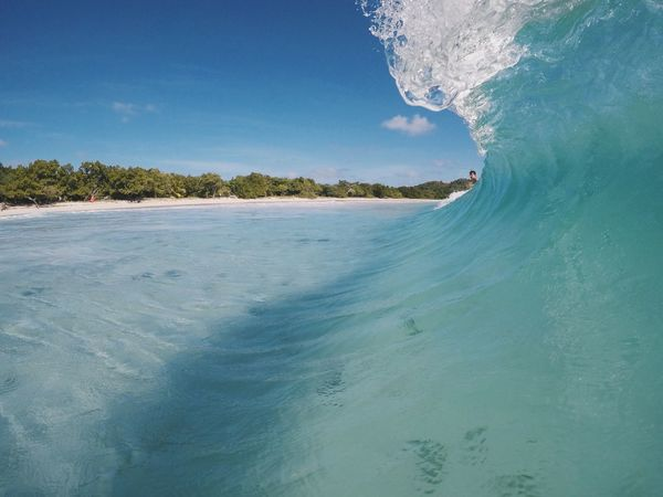 Time : 11:45 am Beach Beauty In Nature Blue Blue Wave Day Landscape Mountain Nature No People Ocean Outdoors Scenics Sea Sky Tranquil Scene Tree Water Waves EyeEmNewHere