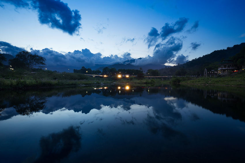 Kiriwong village Beauty In Nature Beauty In Nature Blue Calm Cloud Cloud - Sky Countryside Illuminated Kiriwong Lake Majestic Mountain Nakhon Si Thammarat Nature Non-urban Scene Reflection Remote Scenics Sky Standing Water Tranquil Scene Tranquility Village Water Waterfront