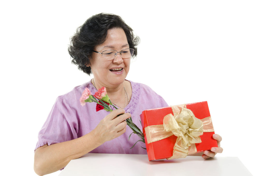 Adult Adults Only Birthday Birthday Present Celebration Cheerful Christmas Christmas Present Eyeglasses  Females Gift Giving Happiness Holiday - Event Mature Adult One Person One Woman Only Only Women People Senior Adult Smiling Studio Shot Waist Up White Background Women