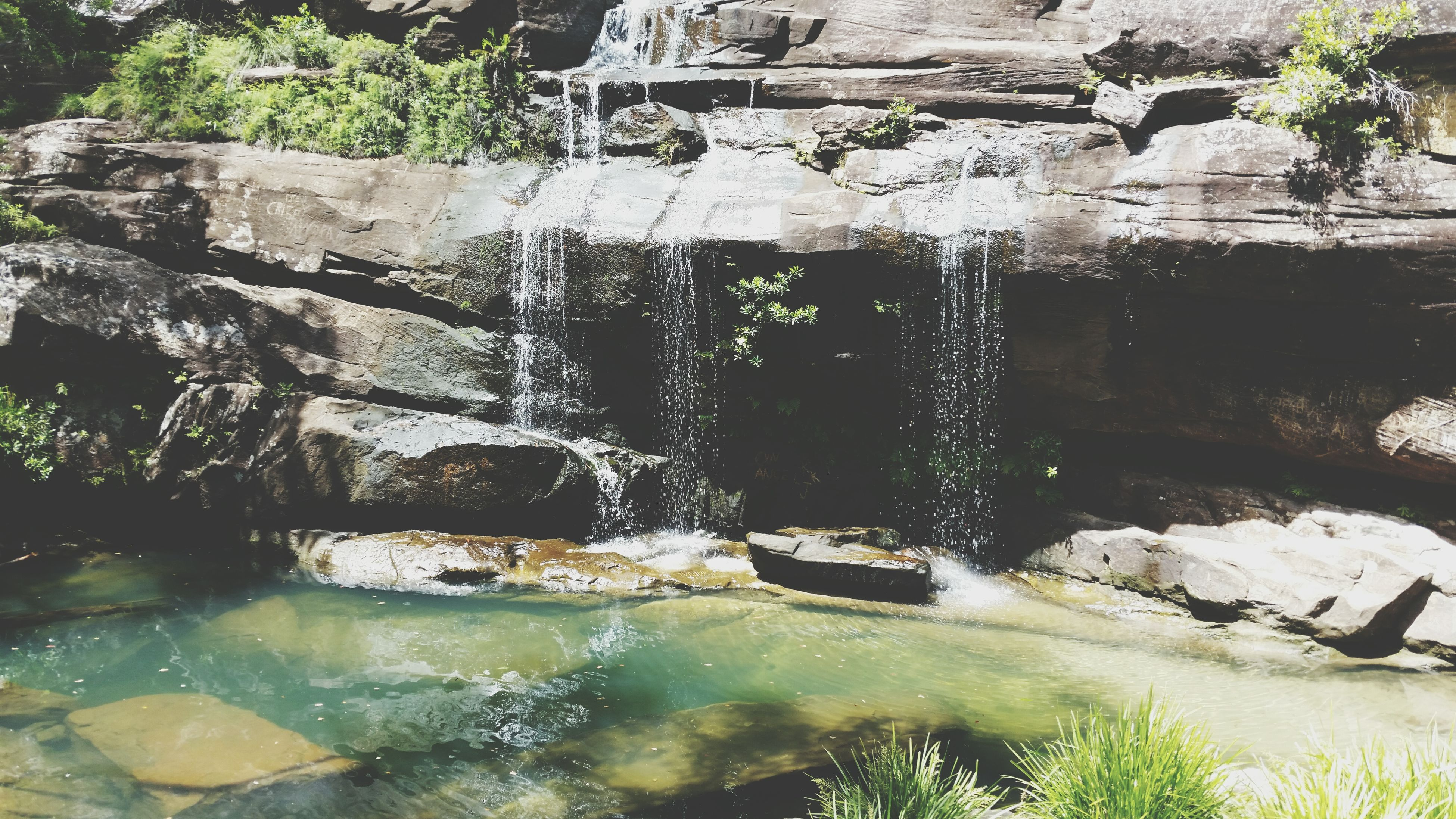 water, rock - object, reflection, flowing water, stream, waterfront, nature, river, plant, flowing, built structure, motion, day, outdoors, tree, no people, beauty in nature, rock, waterfall, architecture