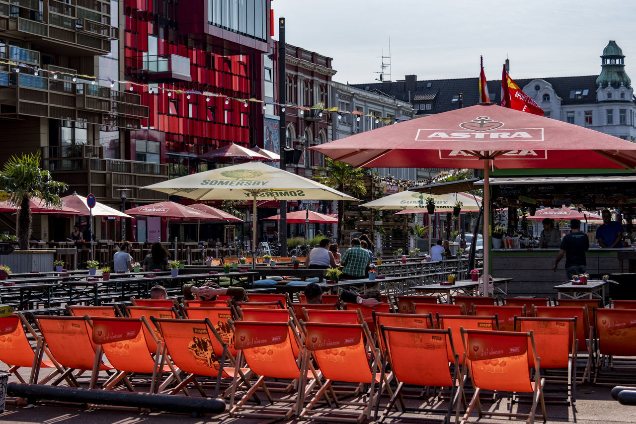 Reeperbahn Architecture Building Exterior Built Structure Chair City Day Group Of People Hamburg Reeperbahn Large Group Of People Men Outdoor Cafe Outdoors Parasols People Real People Seats Sky Spielbudenplatz Summer In The City