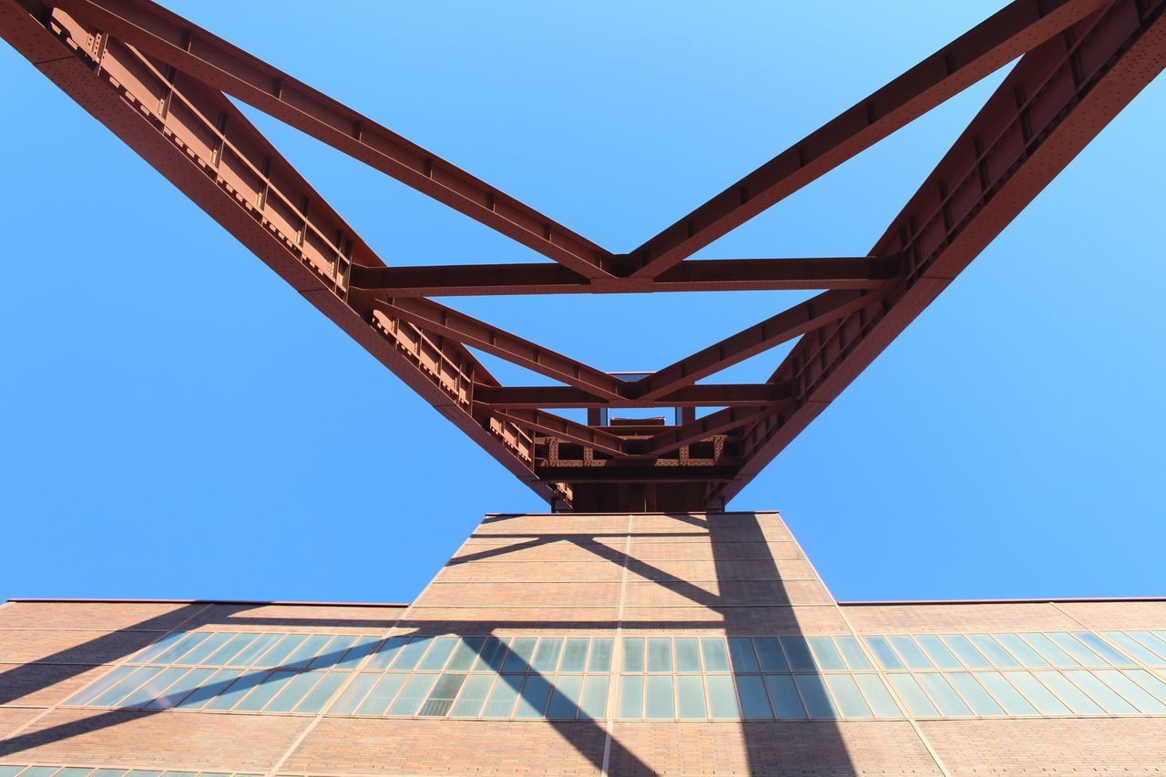 built structure, architecture, clear sky, low angle view, bridge - man made structure, connection, day, blue, outdoors, no people, sky