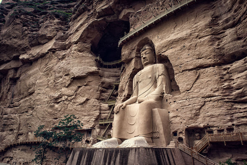 The Bingling Temple is a series of grottoes filled with Buddhist sculpture carved into natural caves and caverns in a canyon along the Yellow River. Bingling Buddha Faith Relaxing XinJiang Yellow River Believe Buddha Statue Buddhism Canyon Carve China Grottoes Natural Caves Sculpture Sculpture Carved Temple Tourist Destination Travel China Travel China Guide