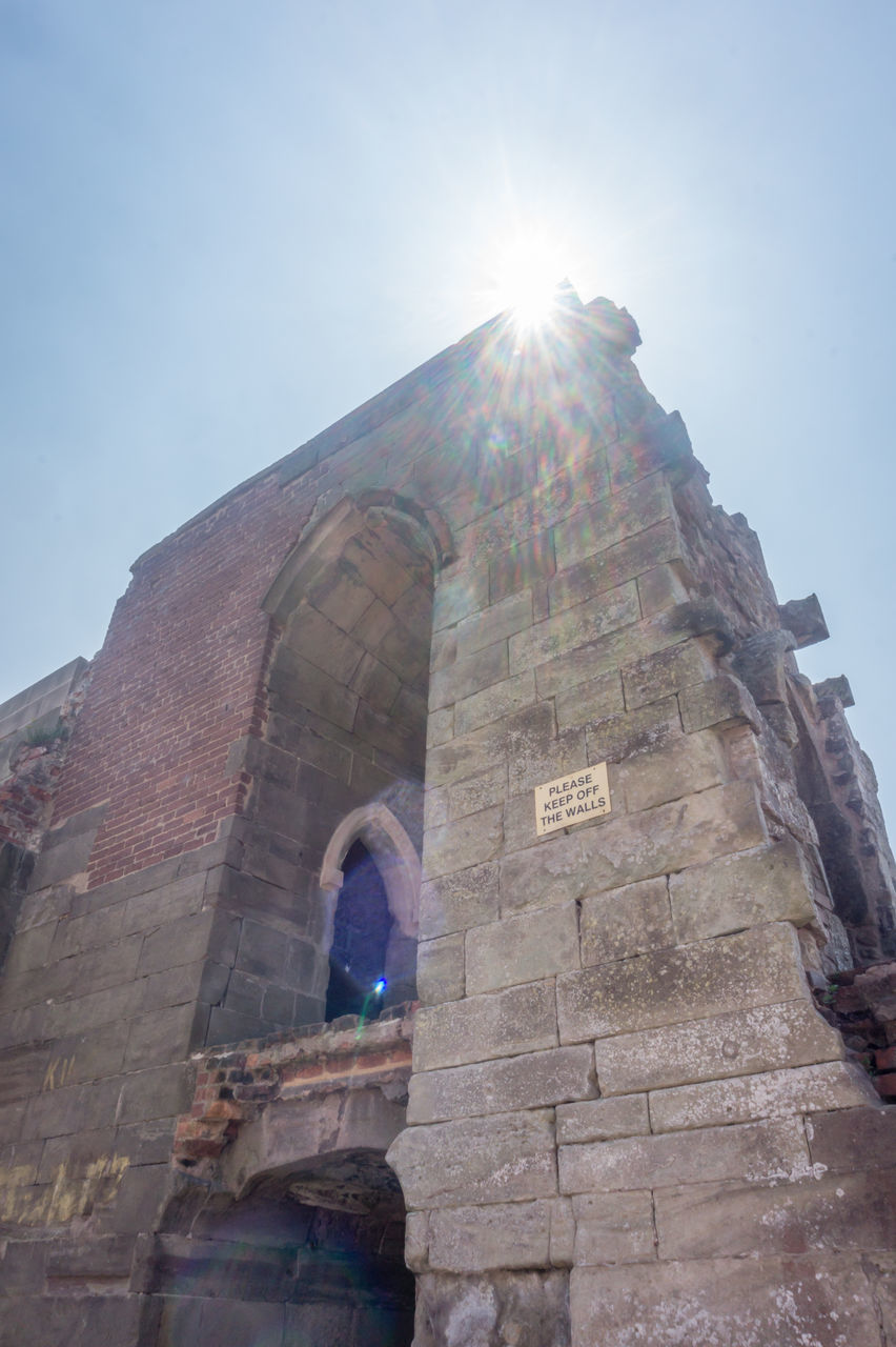 lens flare, low angle view, sunbeam, sunlight, built structure, architecture, sun, spirituality, religion, building exterior, history, place of worship, day, arch, old ruin, clear sky, sky, travel destinations, ancient, outdoors, no people, ancient civilization