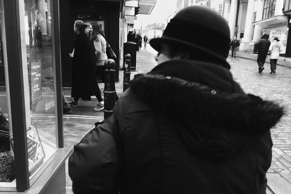Over a shoulder • Street Streetphotography Streetphoto_bw Streetbwcolor Londonstreets Warm Clothing Window Shopping