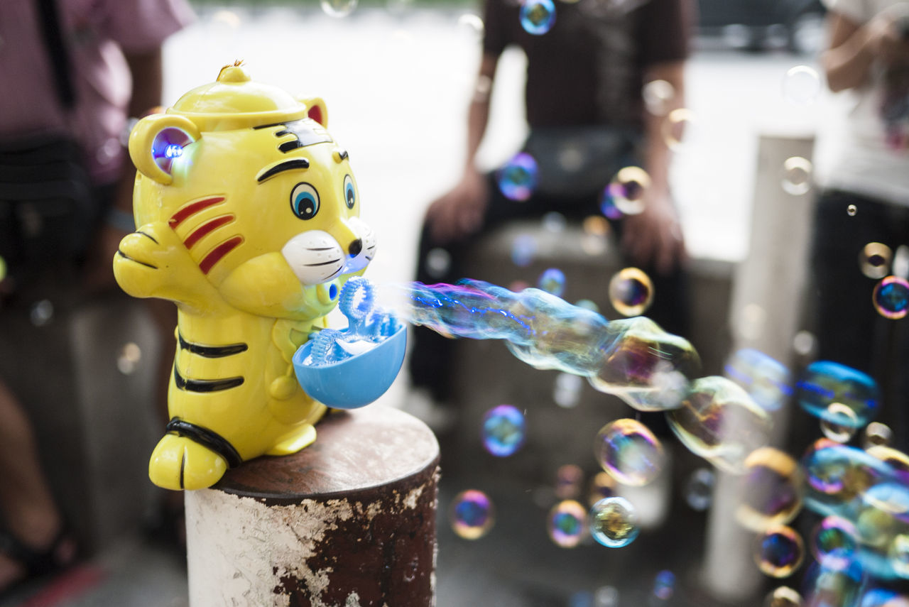 Beautiful stock photos of toys, Bubble, Day, Focus On Foreground, Incidental People