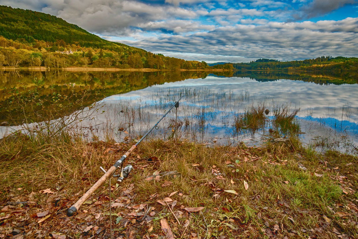 Angling Beauty In Nature Cloud - Sky Day Fishing Fishing Boat Grass Lake Landscape Mountain Nature No People Outdoors Reflection Restful Place Scenics Scotland Wild Landscape Scottish Scottish Highlands Sky Sport Tranquil Scene Tranquility Water