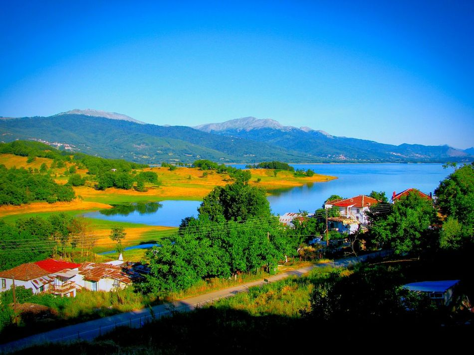 Landscapes With WhiteWall Lake Lake View Village Village And Lake Mountain Mountain And Lake Road Country Road Countryside Landscapes Tranquil Scene Shades Of Blue Plastira Lake Karditsa  Houses Water Reflections Reflected Glory Houses And Lake Landscape Landscape_Collection Greenery No People Blue Wave