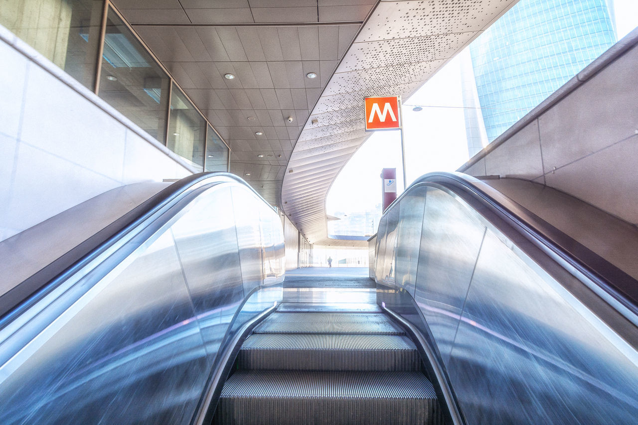 Airport Architecture Building Exterior Built Structure City Day Escalator Exit Sign Futuristic Illuminated Indoors  Modern No People Railing Staircase Steps Steps And Staircases Technology