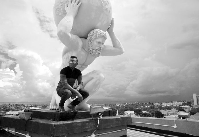 Found an awsum statue on a rooftop Architecture Blackandwhite Built Structure Cloud - Sky Day High Men Sky Statue