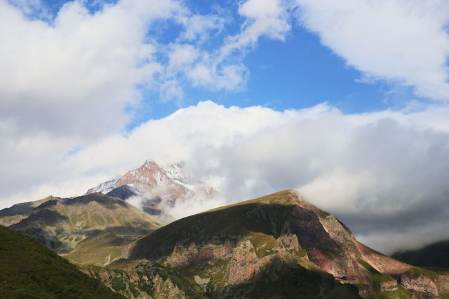 Beauty In Nature Cloud - Sky Day Ethereal Geology High Section High Up Idyllic Majestic Mountain Mountain Peak Mountain Range Nature Non-urban Scene Outdoors Physical Geography Remote Rocky Rocky Mountains Scenics Sky Snowcapped Mountain Tourism Tranquil Scene Tranquility