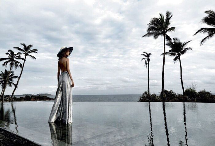 Water Palm Tree Cloud - Sky Sky Sea Nature Tree Tranquility Growth Scenics Horizon Over Water Beauty In Nature One Person Infinity Pool Tranquil Scene Standing Swimming Pool Real People Day Outdoors