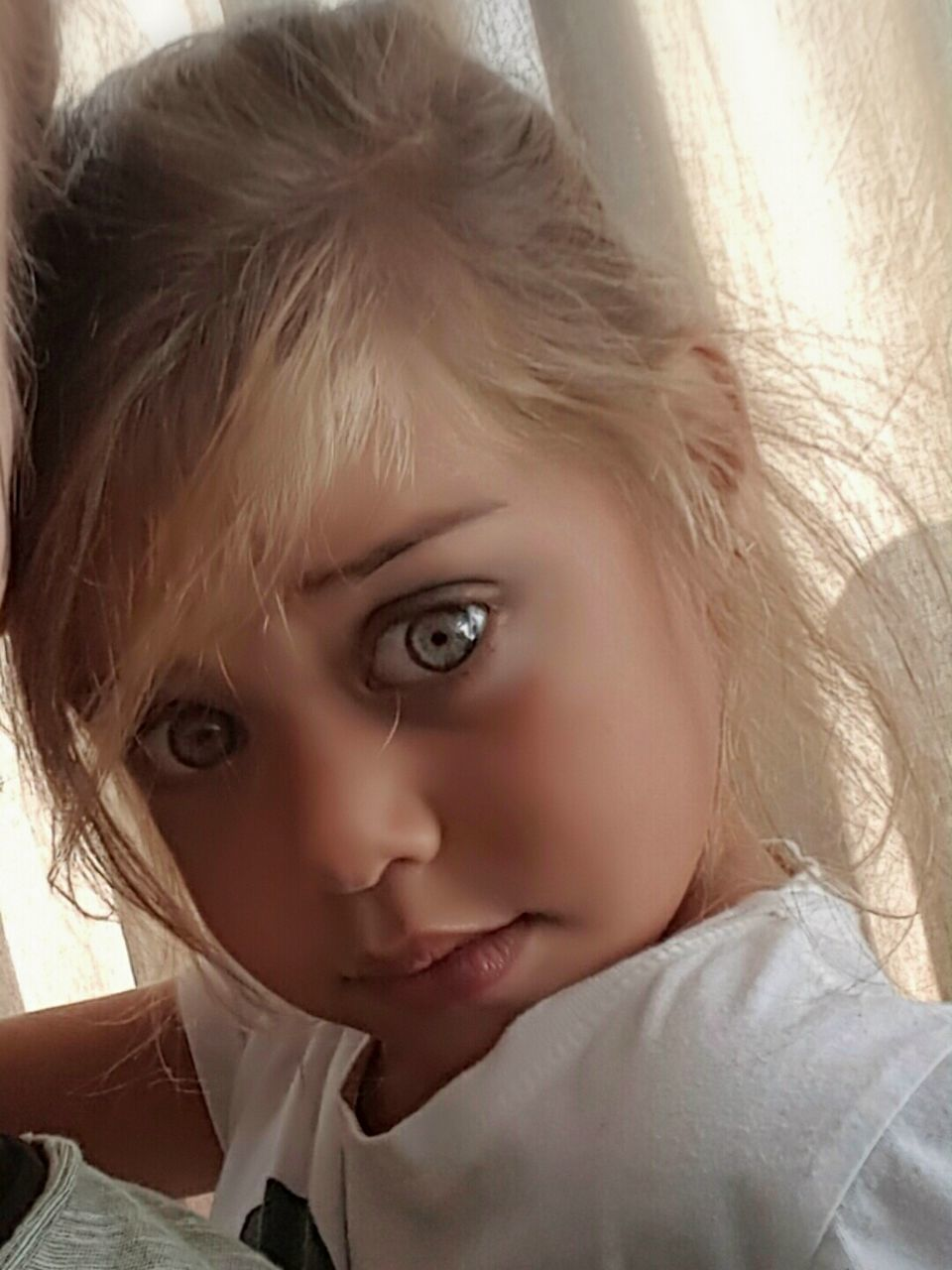 childhood, innocence, elementary age, real people, one person, cute, looking at camera, headshot, portrait, close-up, boys, girls, leisure activity, lifestyles, home interior, human face, indoors, blond hair, day