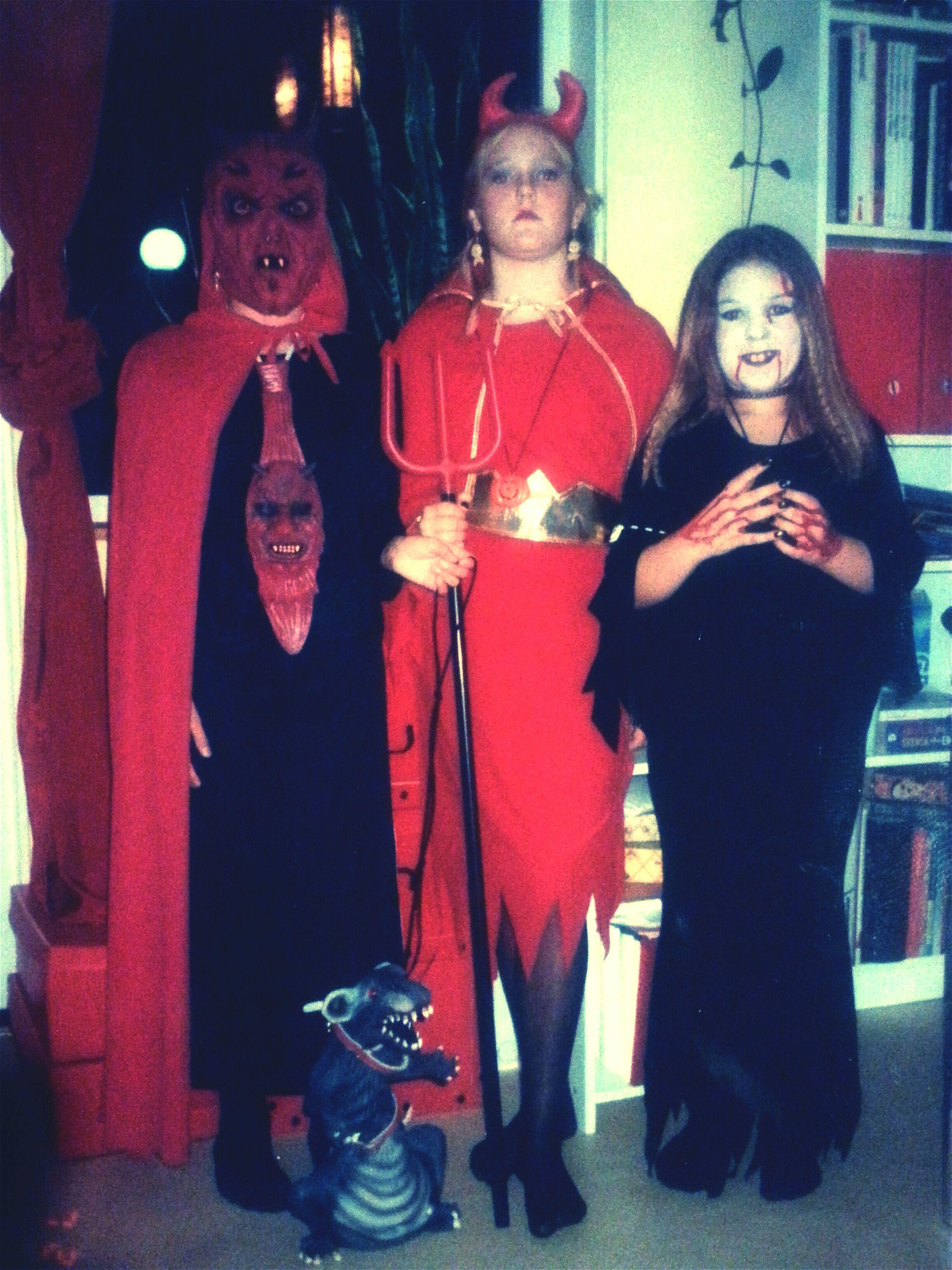 Happy Halloween Devilish Children With Rat-pet Halloweenparttime Three Little Devils Rat In A Leach