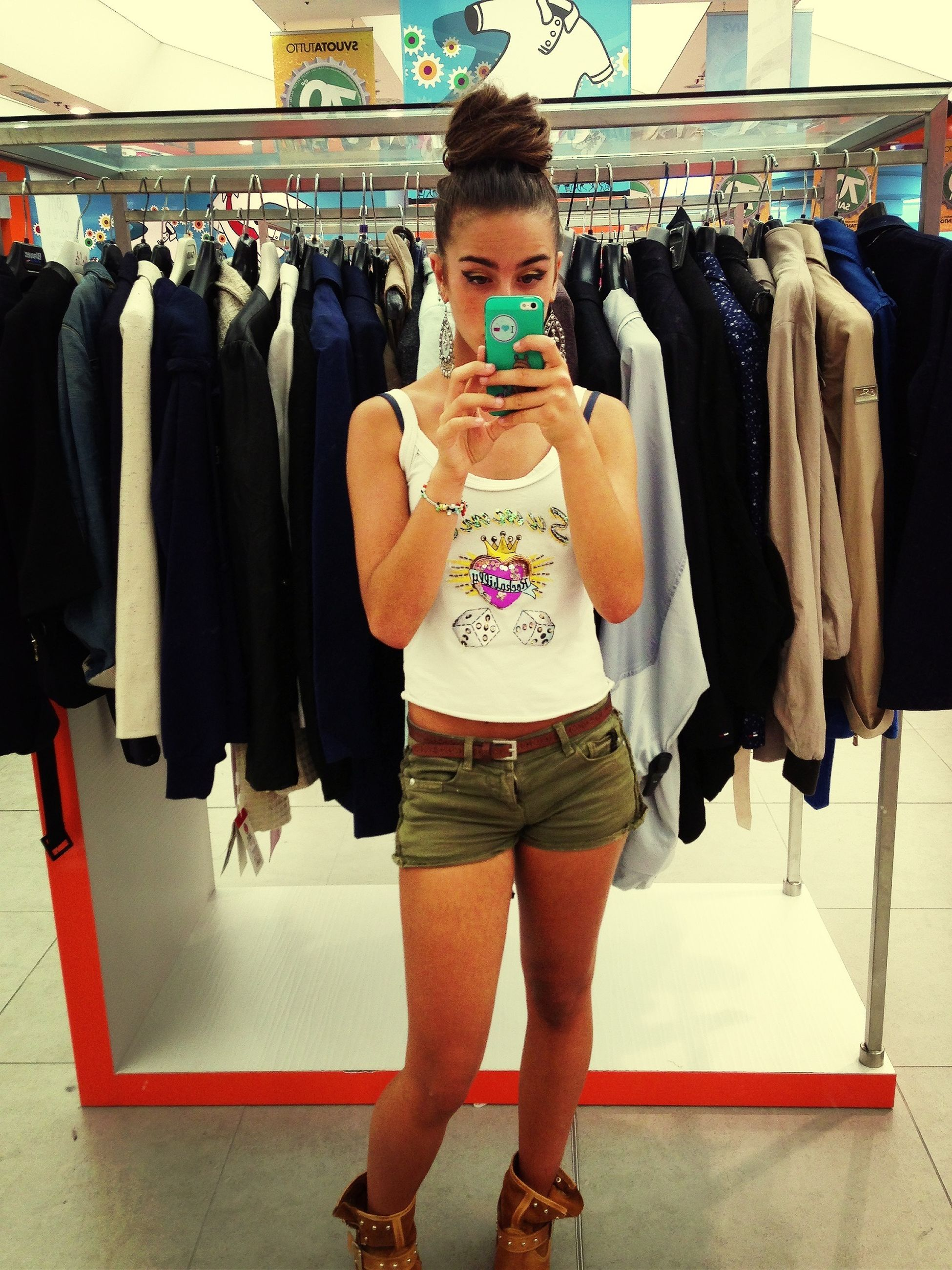 indoors, lifestyles, casual clothing, standing, leisure activity, front view, young adult, person, full length, fashion, three quarter length, young women, smiling, togetherness, portrait, looking at camera, shopping