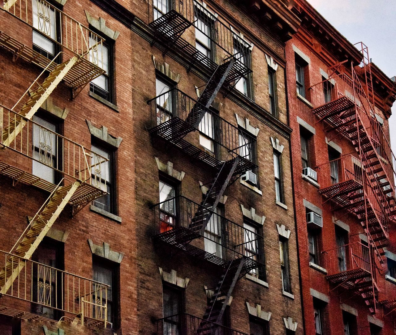 architecture, building exterior, fire escape, built structure, low angle view, window, steps and staircases, staircase, emergencies and disasters, safety, urgency, steps, no people, outdoors, day, sky