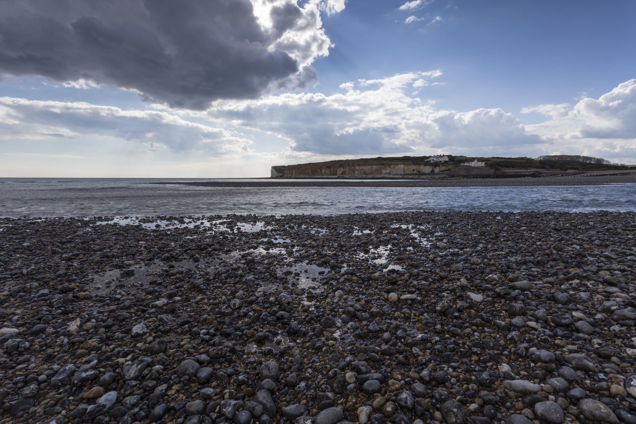 Pebble beach and Cliffs at Cuckmere Haven, Seaford, East Sussex, England, United Kingdom Beach Beauty In Nature Blue Cliffs Cloud - Sky Clouds Cuckmere Haven Day East Sussex Horizon Over Water Nature No People Outdoors Pebble Pebble Beach Pebble Beach Pebbles Rock - Object Scenics Sea Seaford Sky Tranquil Scene Tranquility Water