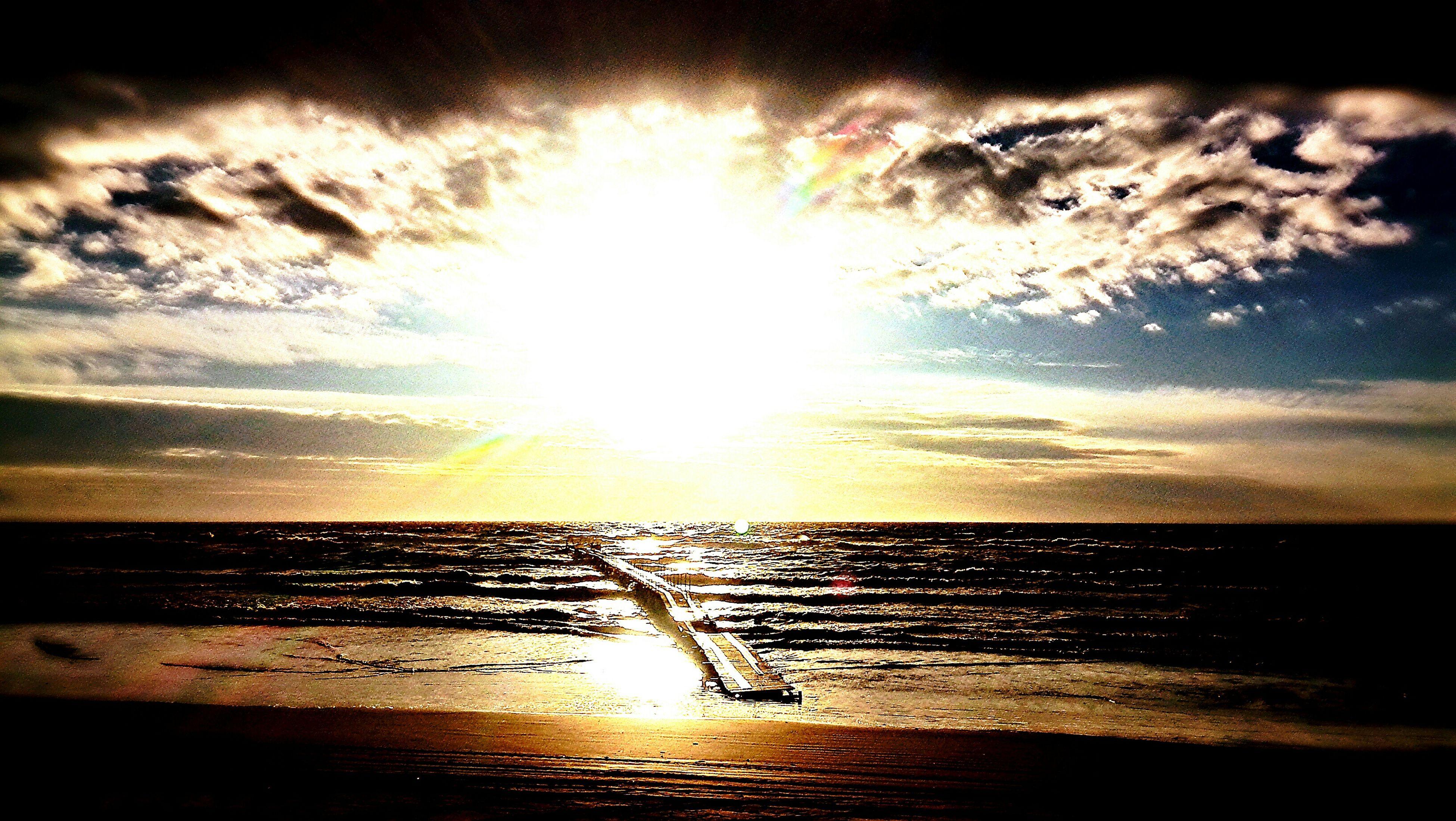 sea, water, horizon over water, sun, beach, sky, sunset, scenics, shore, tranquil scene, beauty in nature, sunbeam, tranquility, reflection, cloud - sky, sunlight, idyllic, nature, wave, lens flare