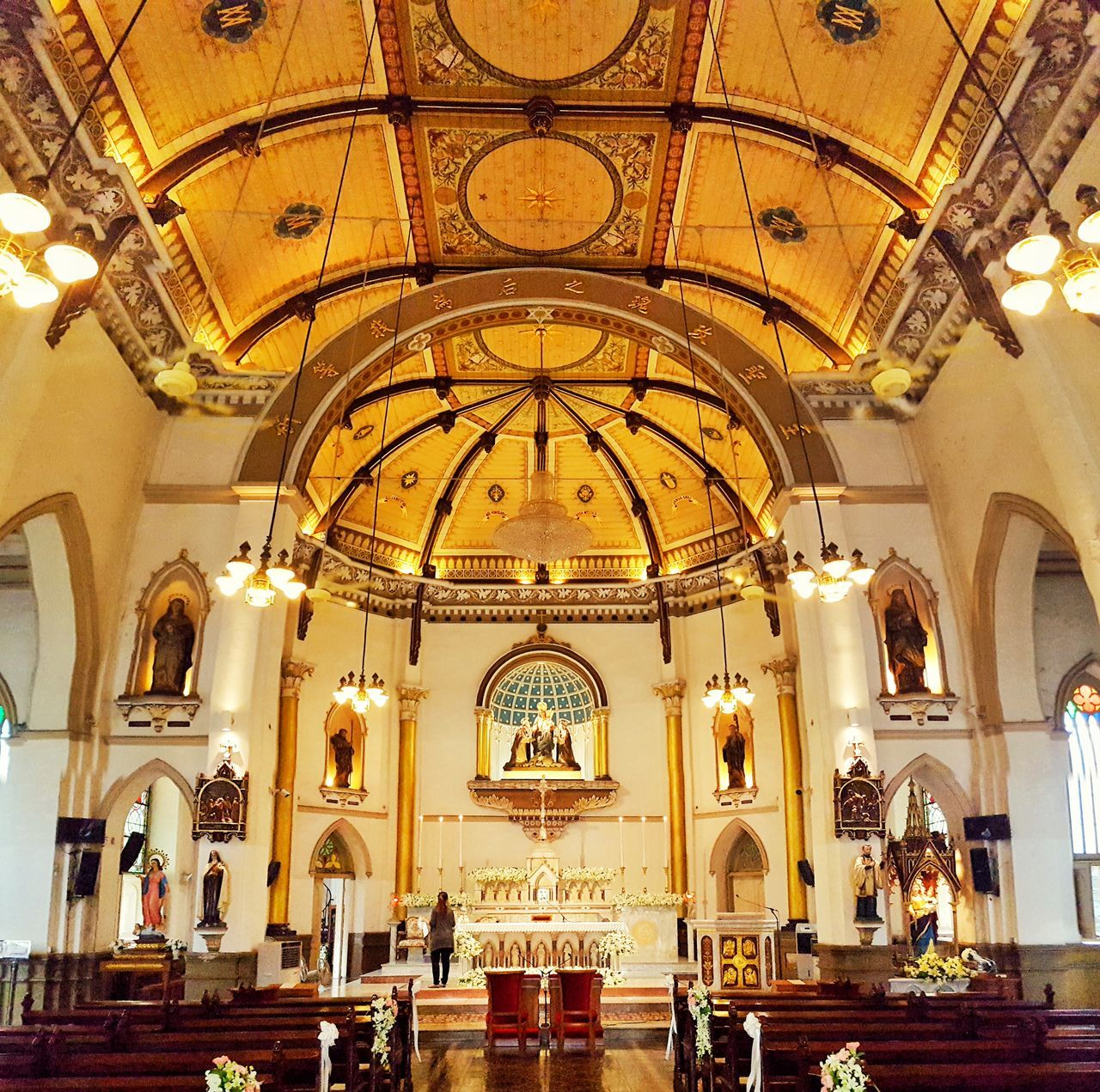 arch, indoors, ceiling, architecture, religion, place of worship, gold colored, illuminated, pew, altar, no people, day