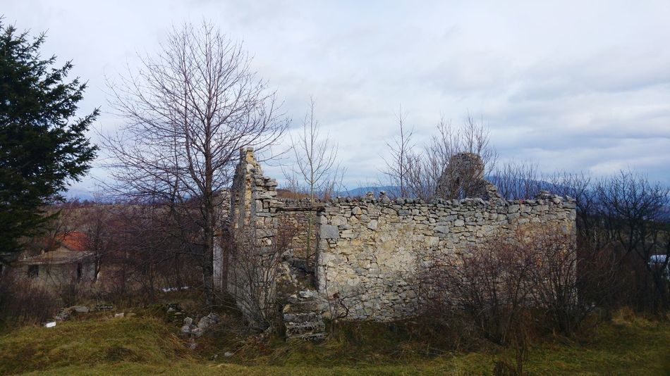 Ruins Trees Baretree Skyscape Ruin Ruins Ruins Architecture Ruined Building Old House - Stone House Stone House Ruins_photography Cloud - Sky Sky Outdoors No People Day Grass Nature