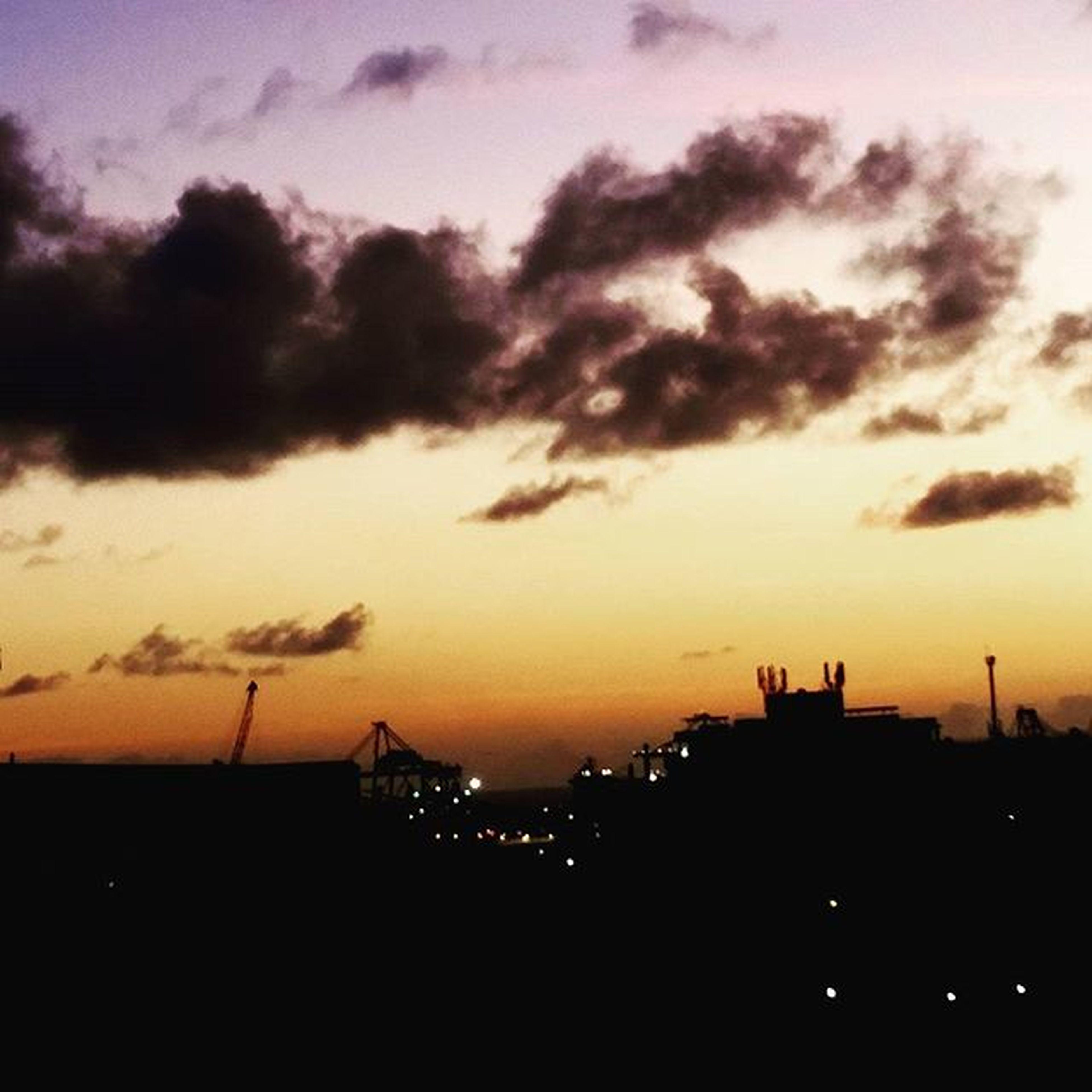 sunset, silhouette, building exterior, architecture, built structure, sky, orange color, cloud - sky, industry, crane - construction machinery, city, development, construction site, dramatic sky, crane, dusk, dark, cloud, outdoors, building