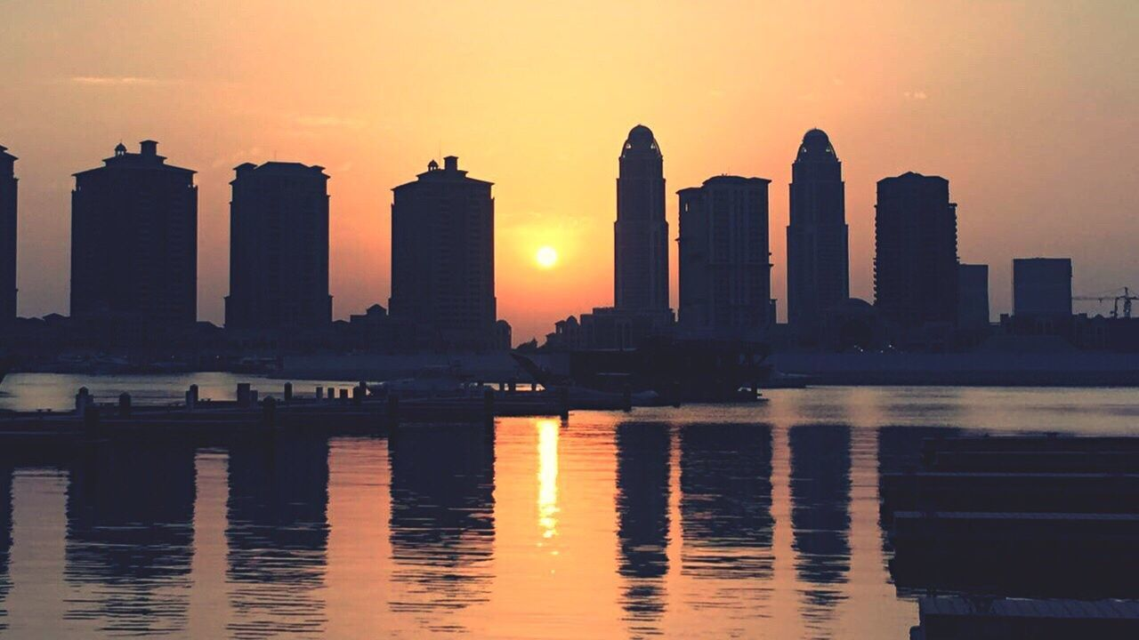 Sunsets are reminders that tomorrow is new brand day !! Beautiful Sunset♥♥Good Evening EyeEm Sunset Orange Sky Sunset Reflection Water Artificial Island The Pearl, Doha Built Structure Building Exterior City Skyscraper Urban Skyline