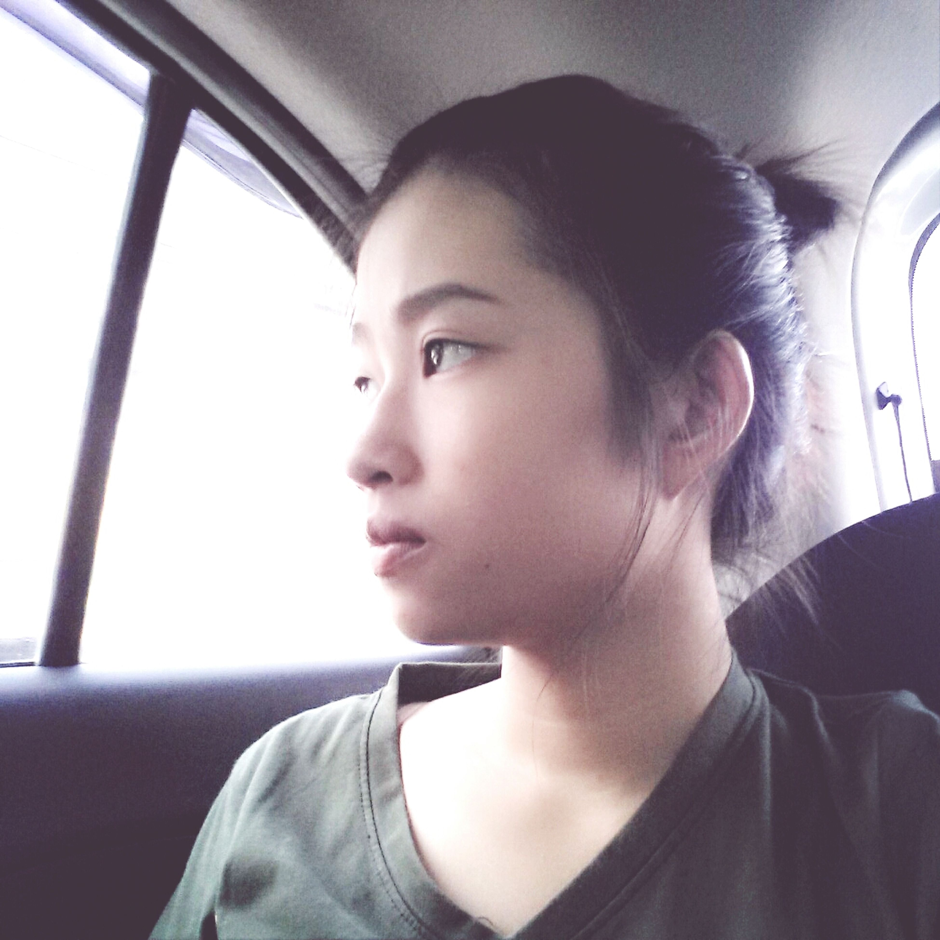indoors, person, headshot, lifestyles, vehicle interior, portrait, looking at camera, young adult, transportation, leisure activity, casual clothing, head and shoulders, front view, window, young women, close-up, mode of transport