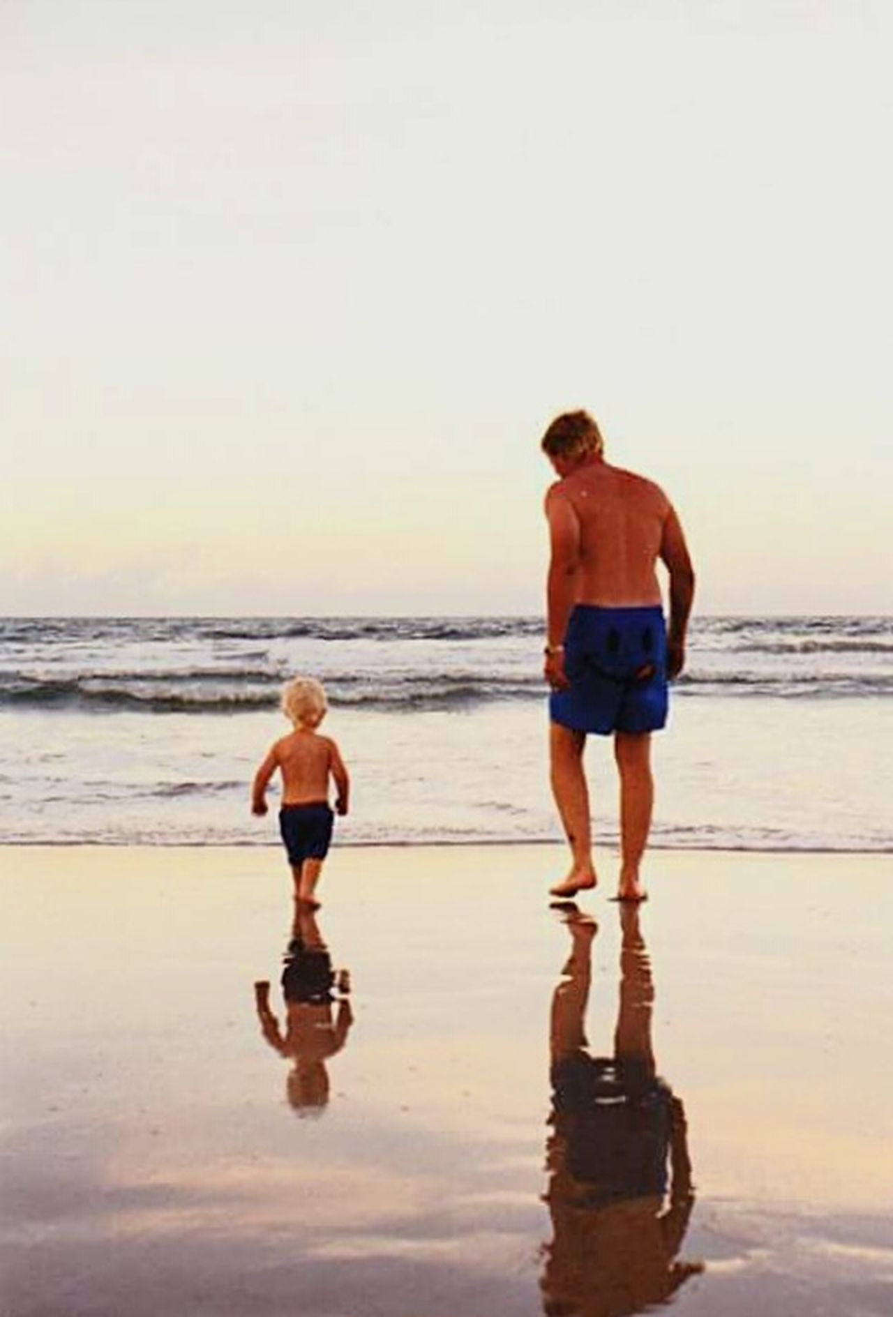 Father & Son Togetherness Beach Boys Son Childhood Outdoors Father Bonding Two People Fun Sand Enjoyment Leisure Activity Beach Photography Vacations Beach View Beachlovers Beach Walk Beachscape Beachtime Reflection Photography Refection In The Sand Reflection_collection Daytona Beach