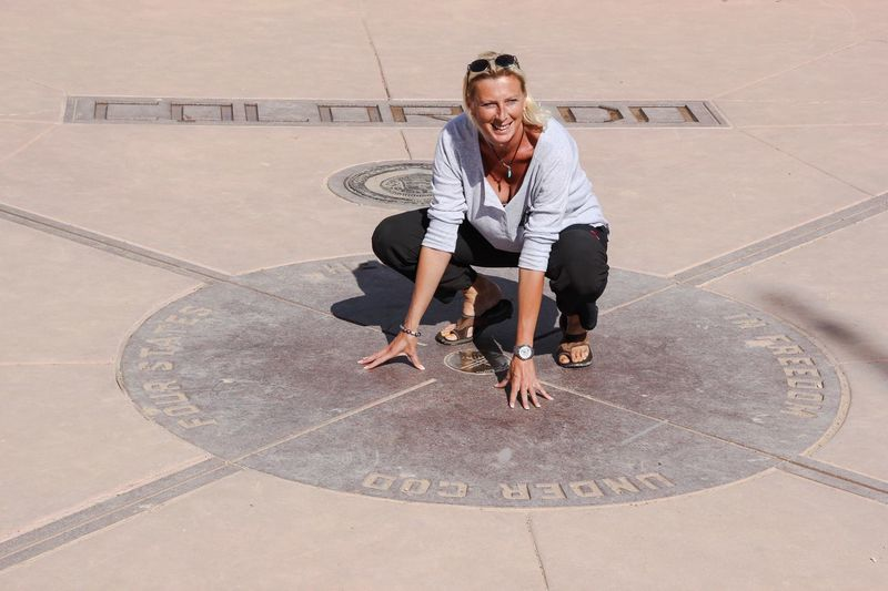 Four corners monument, at the same time in four states Young Adult Full Length Young Men Casual Clothing Sitting Person Friendship Togetherness Day Confidence  Outdoors Handsome Corner 4 States Tourism Tourist Attraction  ThatsMe Tourist Destination USA Four Corners USAtrip Vacations Portrait Of A Woman