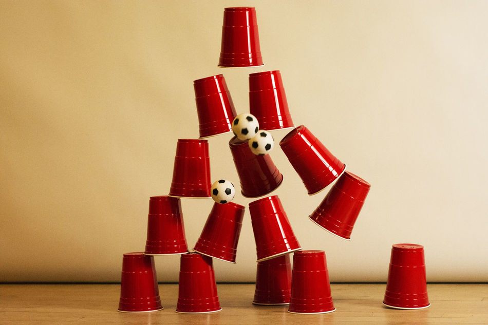 Good shot! Action Shot  Ball Strike Capture The Moment Check This Out Close-up Cup Fever Cup Pyramid EyeEm Best Shots EyeEm Gallery Football Freeze Action Freeze Frame Photography Goal Strike Good Shot Indoors  Mini Footballs No People Red Cups Galore Three Balls Demolish Stack Of Cups Trick Shot