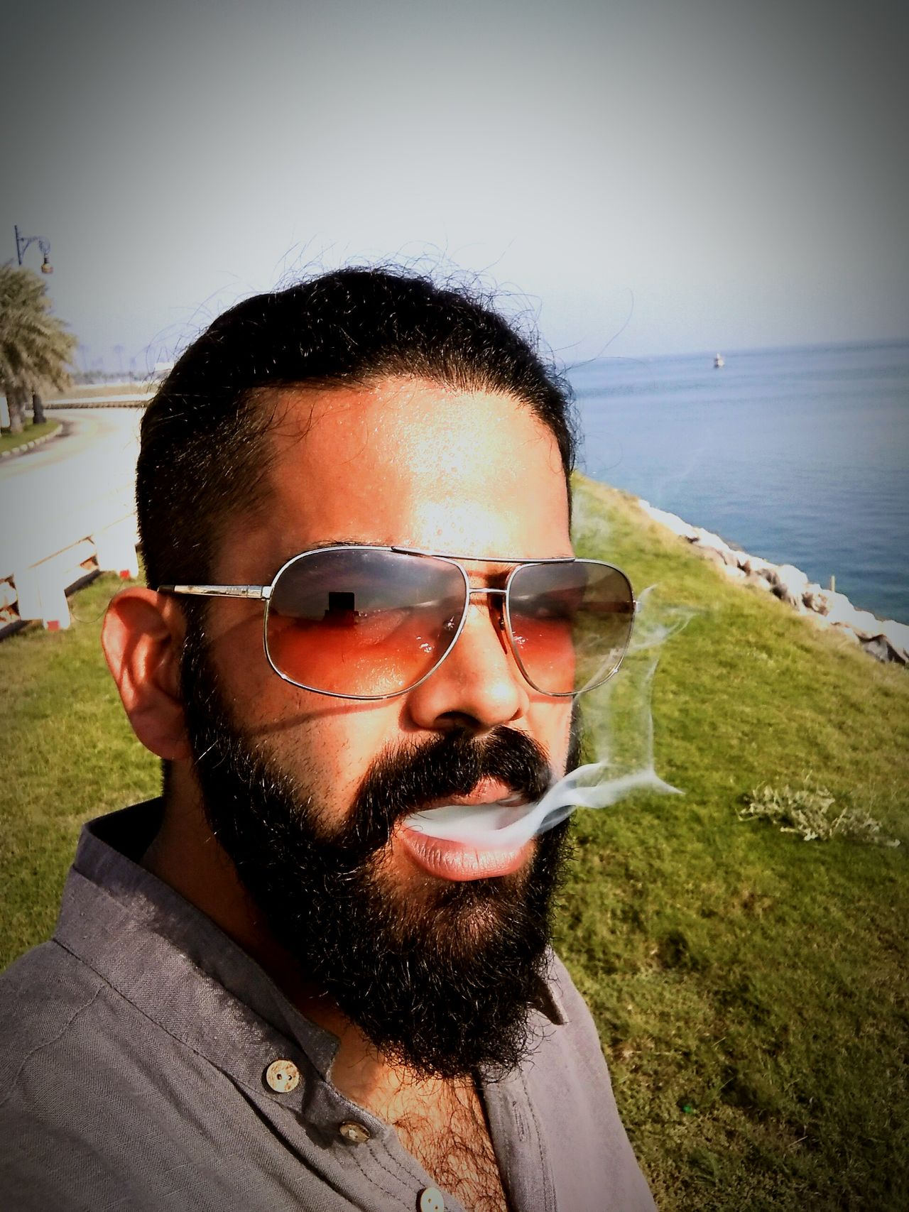 One Man Only Eyeglasses  Young Adult Beard Lifestyles Sky Water Outdoors Close-up Wannabe Self Potrait Headshot Selfobsessed Smokeitout