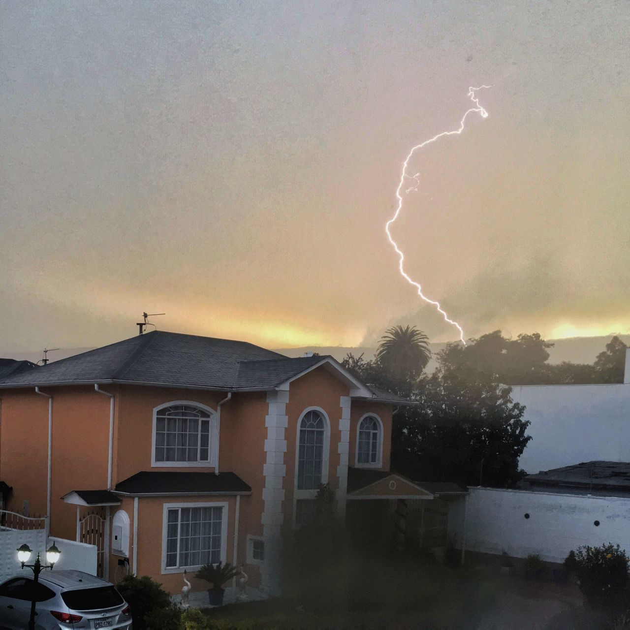lightning, thunderstorm, weather, storm, storm cloud, power in nature, dramatic sky, sky, danger, built structure, building exterior, forked lightning, architecture, cloud - sky, no people, nature, tree, outdoors, beauty in nature, city, day