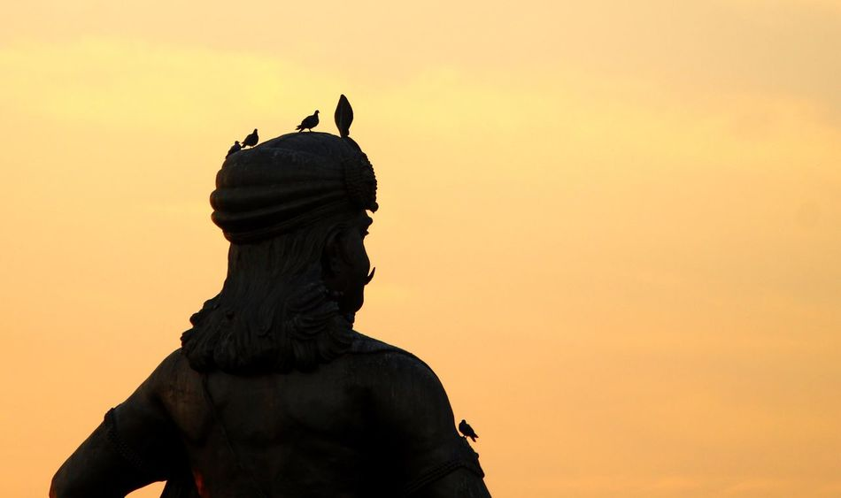 Best place for pigeons Bhopal Silhouette Orange Orange Sky Pigeon Bird  Statue EyeEmNewHere Huge Bird Sky Statue Human Representation Sculpture Art And Craft Male Likeness Creativity Female Likeness Sunset No People Architecture Silhouette Outdoors Angel Sculpted Day