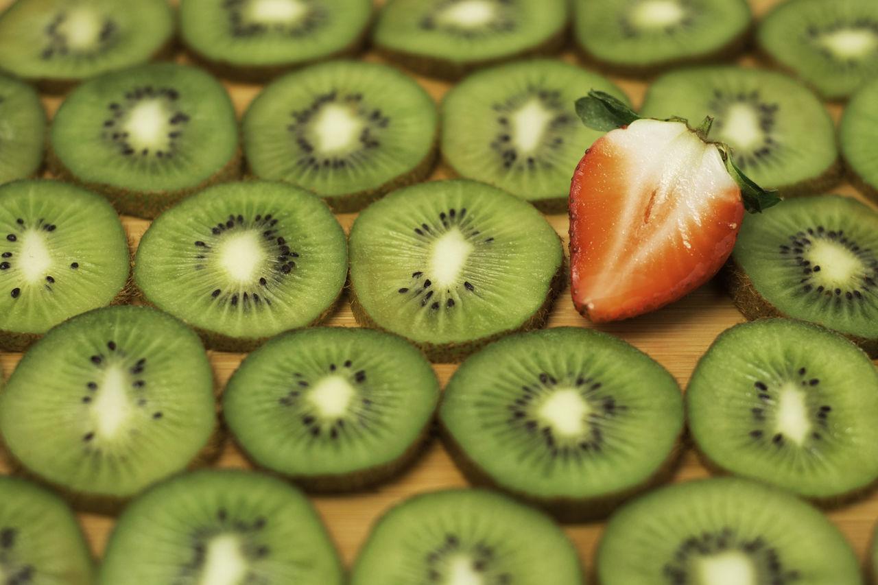 Strawberry Kiwi Abundance Backgrounds Close-up Day Design Food Food And Drink Freshness Fruit Full Frame Green Color Healthy Eating Indoors  Kiwi No People Pattern Seeds Shape SLICE Snack Strawberry Summer