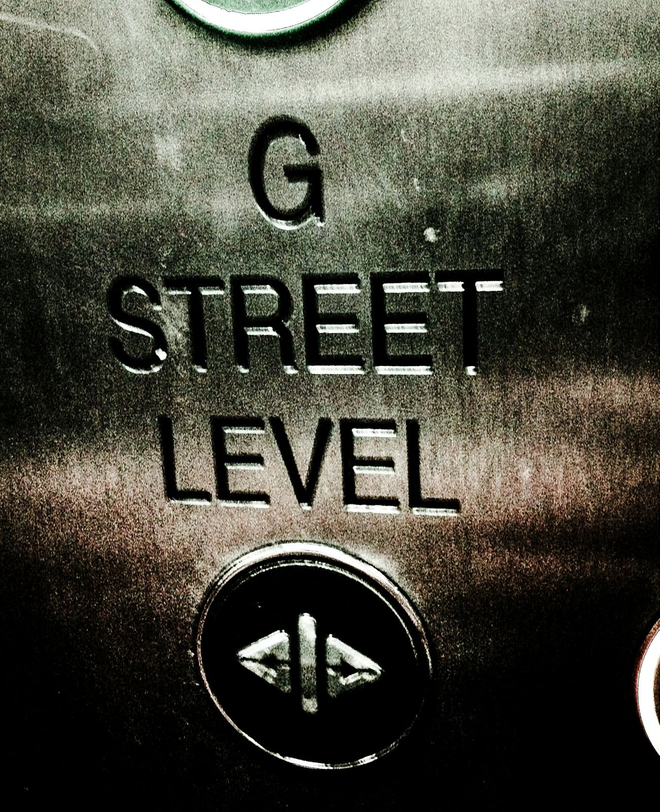 The level of operation. Taken in a lift in Manchester. Street Urban Laser Cut Engraving Metal Metallic Lettering Elevator Manchester