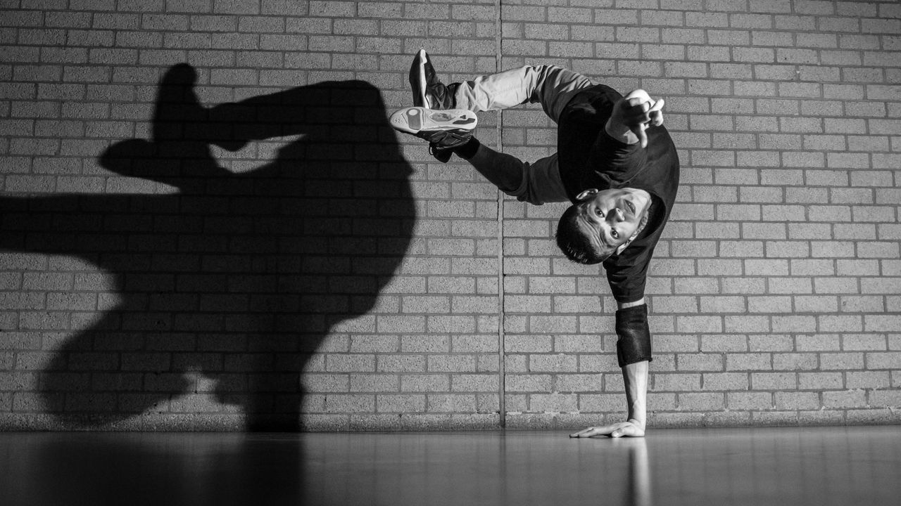 Break Dance Dance Handstand  Indoors  Lifestyles One Hand Real People Shadow Street Wall