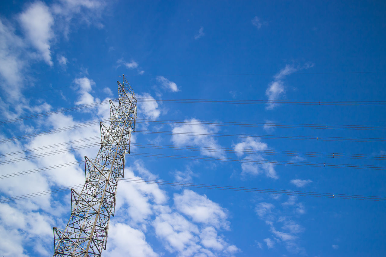 electric tower Beauty In Nature Blue Cloud - Sky Day Electric Tower  Low Angle View Nature No People Outdoors Sky Sunlight Tree Vapor Trail