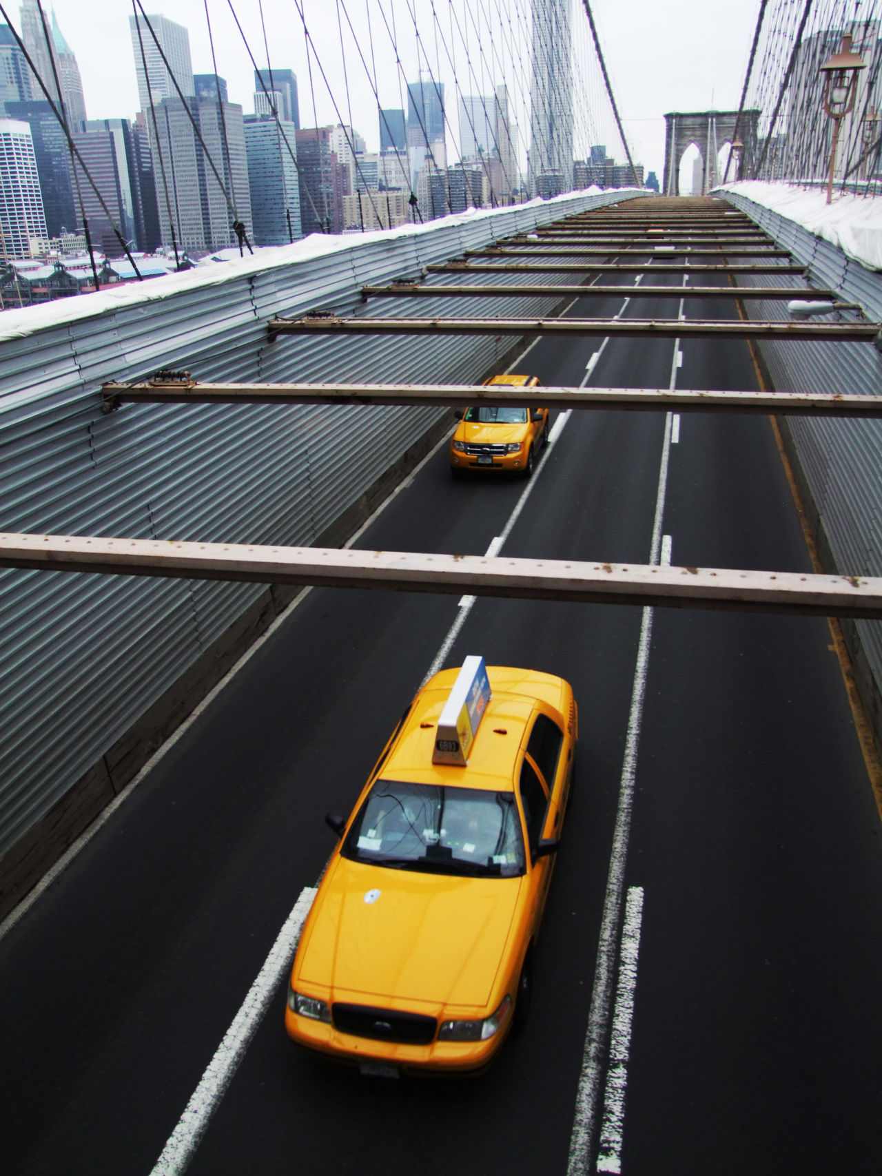 NYC classics Architecture Bridge Brooklyn Brooklyn Bridge / New York Building Exterior Built Structure Car City Day High Angle View Historical Building Manhattan New York City No People NYC Outdoors Skyline Skyscraper Street Suspension Bridge Taxi Transportation USA Yellow Yellow Taxi
