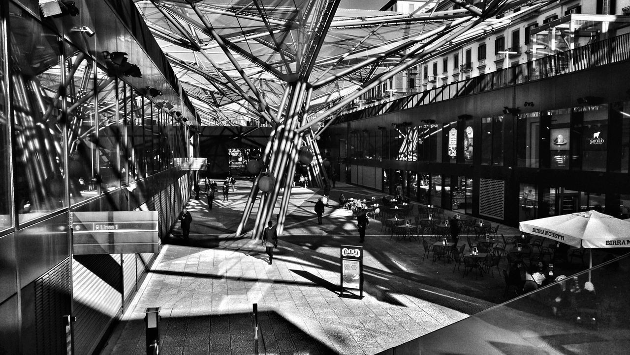In the Moment | Napoli, marzo 2017Arts Culture And Entertainment Shapes , Lines , Forms & Composition Indoors  Day Greenhouse Railway Station Underground Station  Streetphotography Streetphoto_bw People And Places People Journey Shadows Shadows And Light Outdoors Italy Naples Bar Birramoretti Urban Geometry Urbanphotography HuaweiP9Photography Urban Architecture Urban Exploring Urban Scene