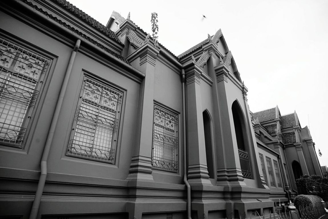 """Monochrome Photography Thaiarchitecture """"Taworawadu"""" buildings or Red buildings in front of the Thai Bhuddism moung colledge Bangkok Thailand Building Exterior Architectural Feature Tall - High History Low Angle View"""