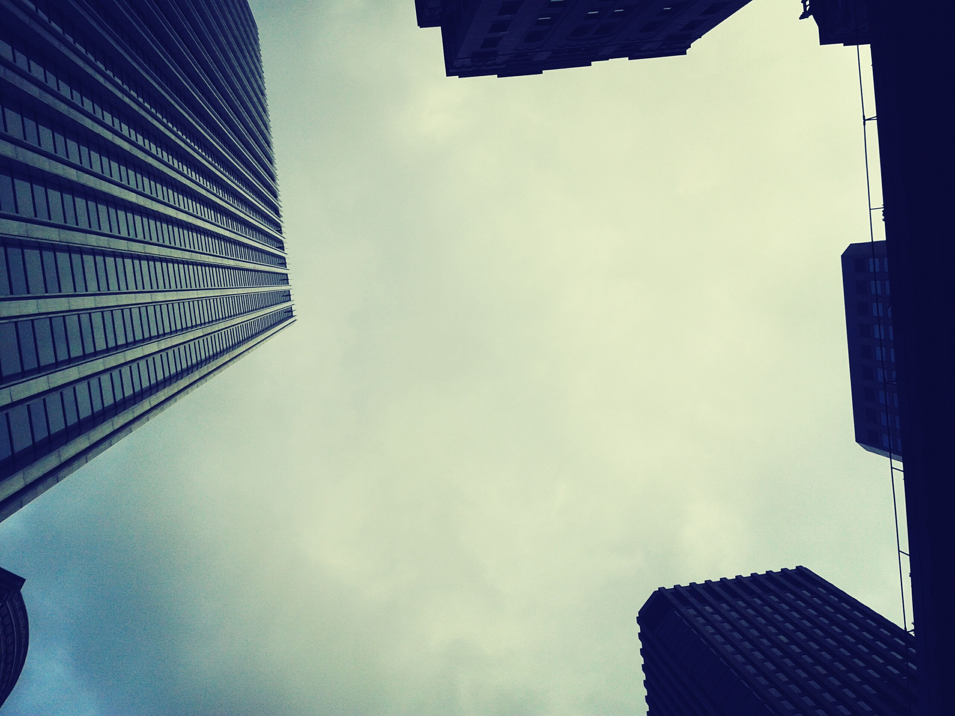 building exterior, architecture, built structure, low angle view, sky, city, building, skyscraper, office building, tall - high, modern, tower, cloud - sky, outdoors, day, residential building, no people, directly below, blue, cloud