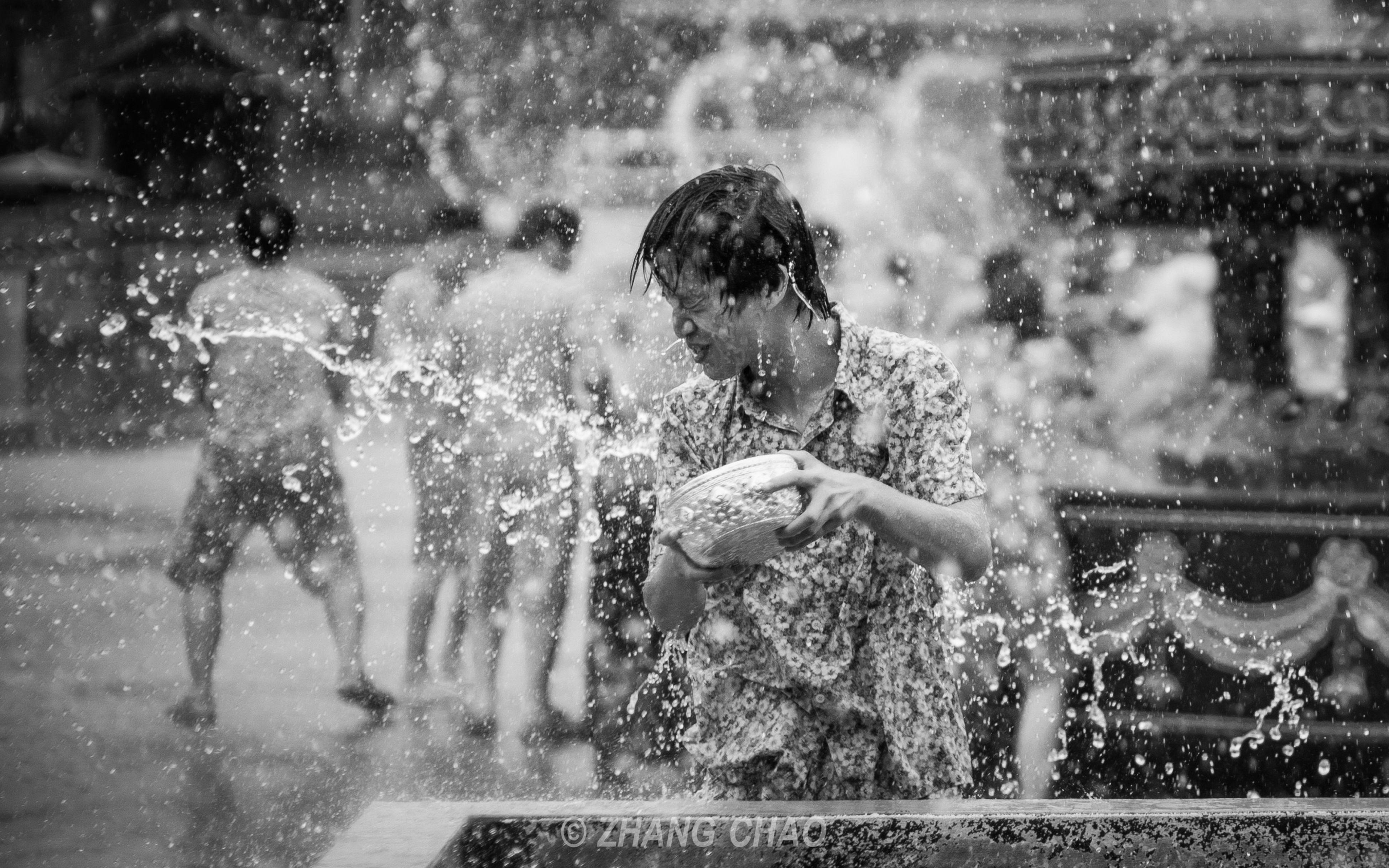 lifestyles, leisure activity, water, motion, wet, splashing, enjoyment, fountain, season, men, spraying, blurred motion, rain, weather, drop, fun, person, boys