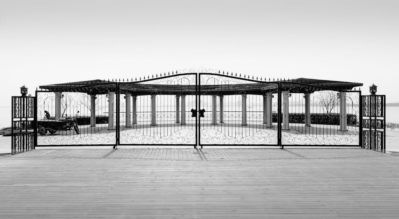 Knockin' on Heaven's Door Black & White Entrance Fence Gate Lantern Outdoor Pergola Pillars Of Light Space Symmetry Tranquility Wrought Iron Gates